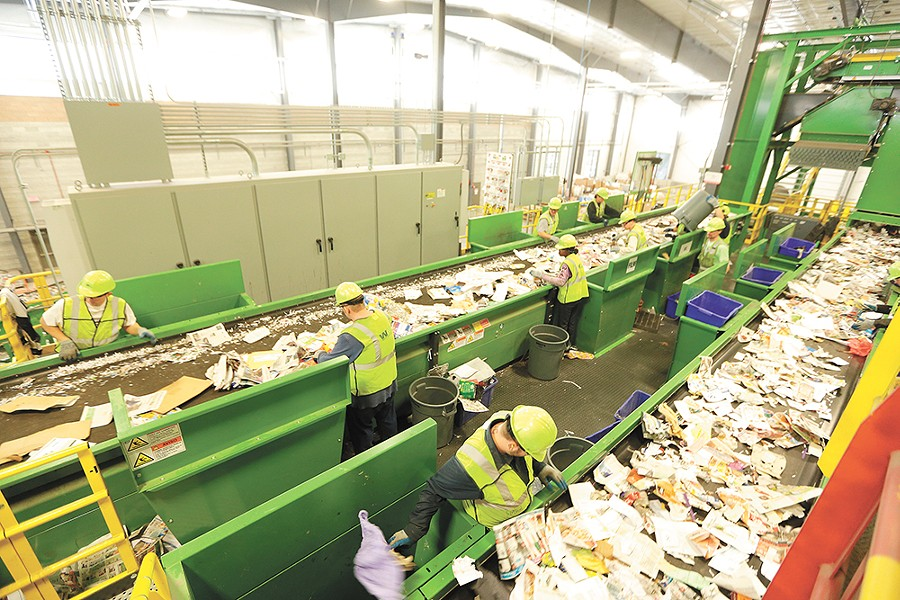 Employees at facilities like Spokane's SMaRT Center hand-pick garbage from the recycling material. - YOUNG KWAK