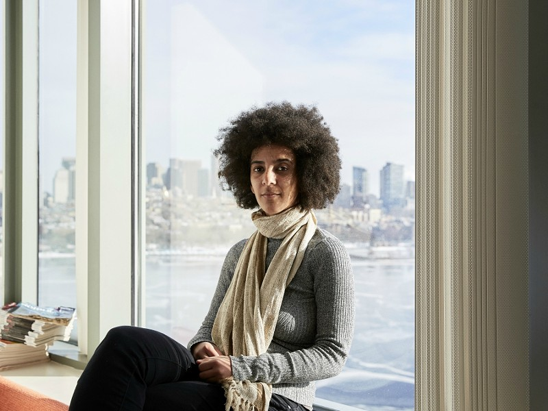 "Timnit Gebru, who led a research effort based at Stanford University that analyzed 50 million images and location data from Google Street View, in Boston, Dec. 29, 2017. Artificial intelligence is making it possible for Street Views to be mined for insights about the economy, politics and human behavior — just as text mining has done for years. ""This kind of social analysis using image data is a new tool to draw insights,"" she said. - CODY O'LAUGHLIN/THE NEW YORK TIMES"