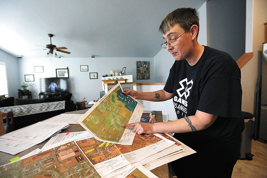 Terry Horne looks at a map showing a wetland in her neighborhood. - YOUNG KWAK