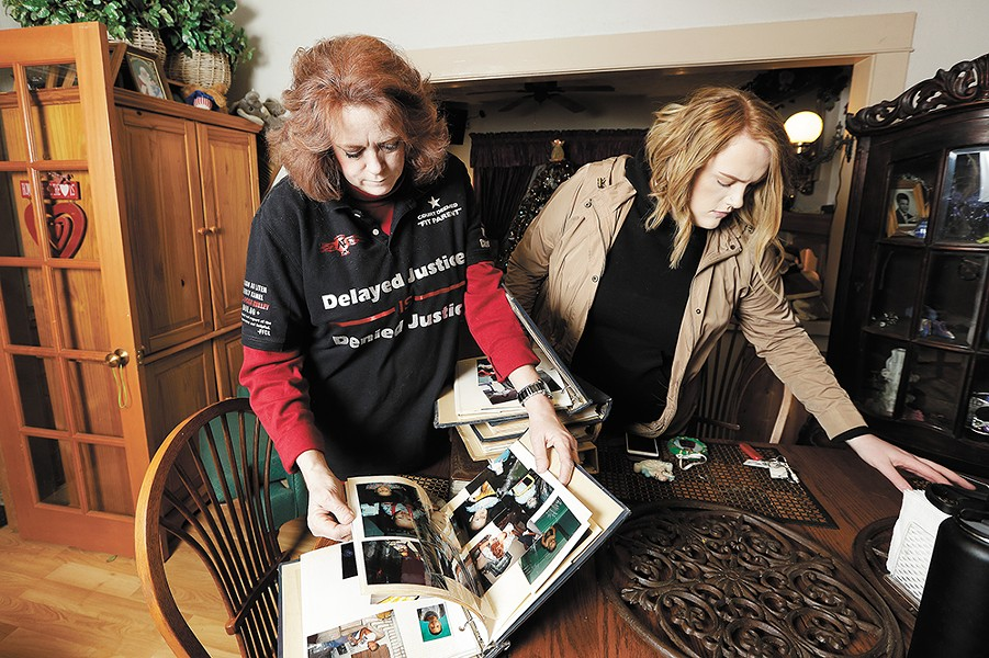 Teresa Simon and her daughter, Megan Juneau, go through old family photo albums. - YOUNG KWAK