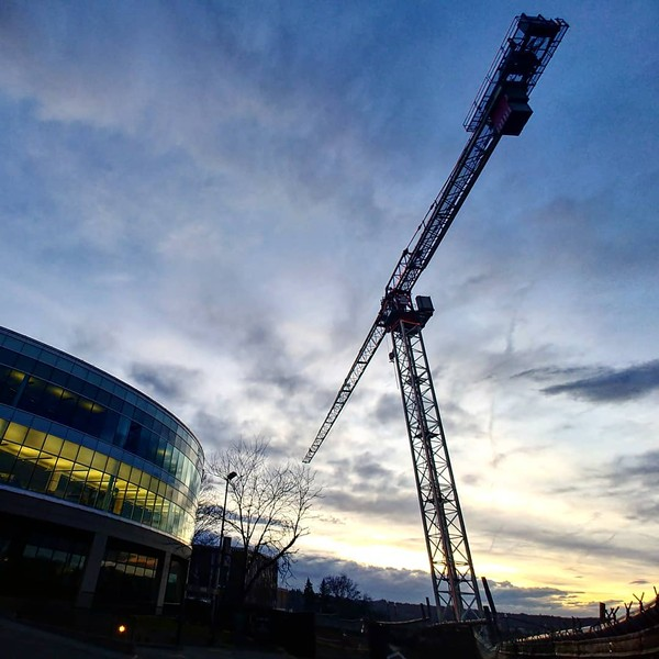 A crane rises up above the downtown Spokane library. - DANIEL WALTERS PHOTO