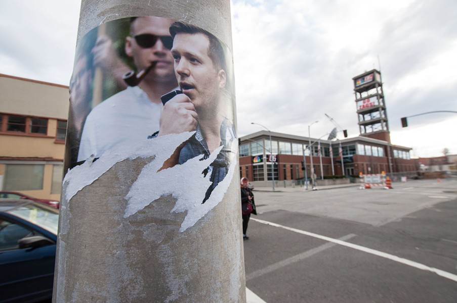 The remnants of a torn poster for the white supremacist group Identity Evropa lingers on a light pole in downtown Spokane Sunday. - DANIEL WALTERS PHOTO