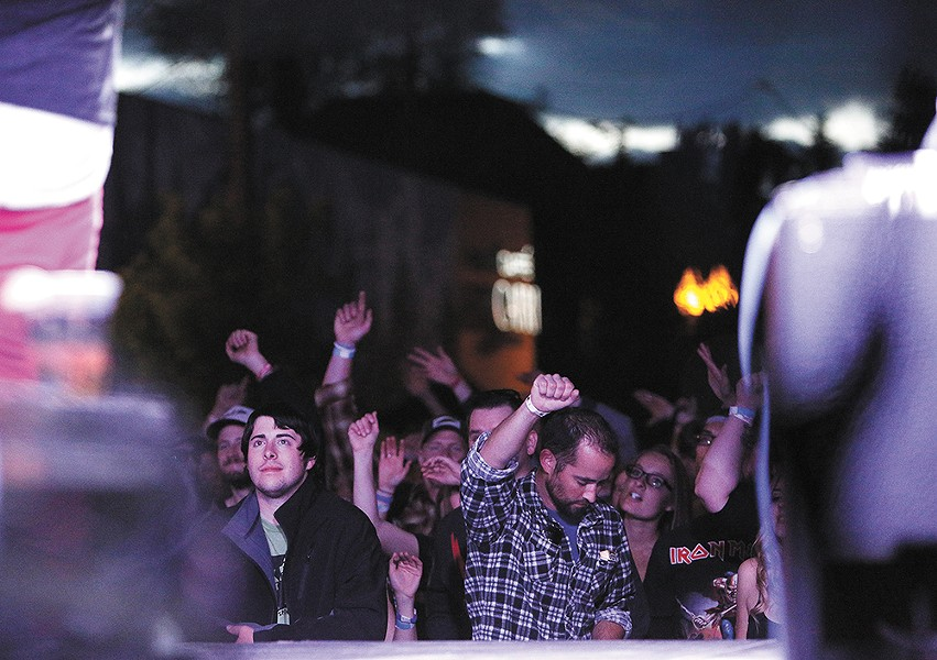 Elkfest's big crowds have been an economic boon to neighborhood businesses — but have sparked complaints from some local residents. - YOUNG KWAK
