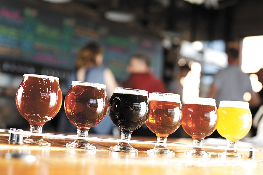 A flight of beers at Iron Goat Brewing. - YOUNG KWAK