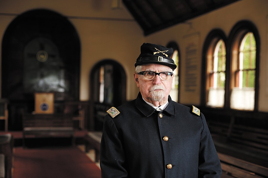 North Idaho Museum visitors love a man in uniform: Robert Singletary at Fort Sherman Chapel. - YOUNG KWAK