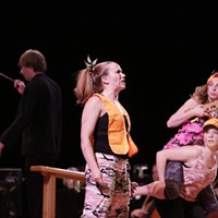 Spokane Symphony + Terrain: Uncharted Bughouse Dance Theater's Laura Shellooe, left, looks up as Marta Nelson, right, holds Elizabeth Belyey on her back as they play the role of The Hunters.