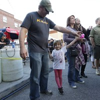 Saturday Evening At Elkfest 4 year old Reese McKinley dances with her father Josh McKinley while Folkinception performs. Young Kwak