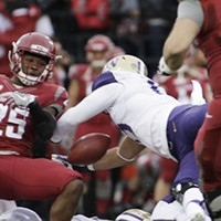 Apple Cup 2016 Washington State running back Jamal Morrow, left, fumbles the ball, which is recovered by Washington linebacker DJ Beavers, during the first half. Young Kwak