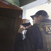 2016 Year in Review: Photos by Young Kwak Bail Enforcement and Fugitive Recovery Agent Scott G. draws his firearm when he discovers a person hiding in a room at a house that while serching for a fugitive, Monday, Feb. 1, 2016, in Spokane, Wash. (Young Kwak/Pacific Northwest Inlander) Young Kwak