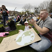 March For Science In Spokane Jacob Wood, right, applauds as his 6 year old daughter Valentina Wood looks on in Riverfront park. Young Kwak