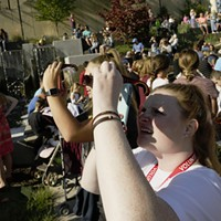 Partial Solar Eclipse in Spokane Kailyn Hudson, right, and Bailey Bordelon capture a partial solar eclipse using their phones and solar glasses, at the Spokane Tribal Gathering Place. Young Kwak