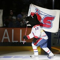 Kootenay Ice vs. Spokane Chiefs Spokane Chiefs mascot Boomer waves the team flag before the game. Young Kwak