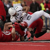 Montana State vs. Eastern Washington Football Eastern Washington linebacker Ketner Kupp, left, defensive back Tysen Prunty, second from the left, and defensive back Mitch Fettig, right, tackle Montana State running back Nick LaSane during the first half. Young Kwak