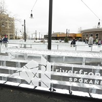 Saturday at the Riverfront Park Ice Ribbon on the Opening Weekend An ice sculpture with the park logo is photographed. Young Kwak