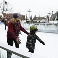Saturday at the Riverfront Park Ice Ribbon on the Opening Weekend Jennifer Clarke, left, helps her 7 year old son Danner Clarke skate. Young Kwak