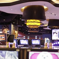 New Slideshow Slot machines and a chandelier representing a drum circle at the Spokane Tribe Casino. Young Kwak