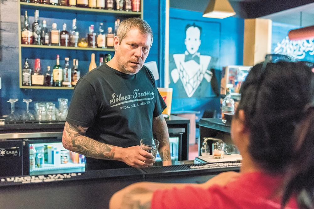 With bright blue walls and open floor, Berserk bar brings