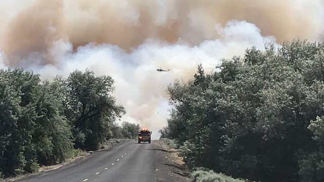 Central Washington fire puts smoke cloud over Eastern Washington, fighting intensifies in Libya and other headlines