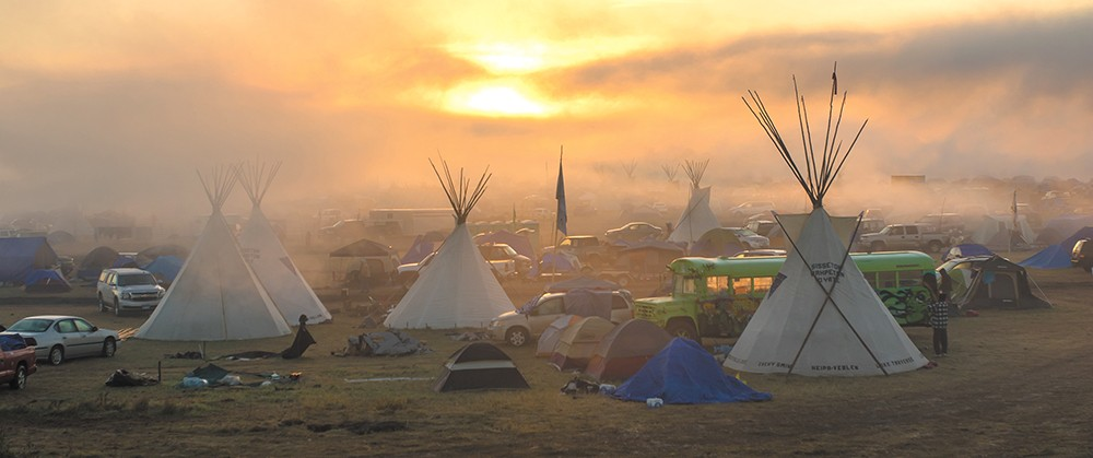 Sunrise on Sept. 17 at the Sacred Stone Spirit resistance camp along the Cannon Ball River near the Standing Rock Sioux Tribe's reservation. - JEFF FERGUSON