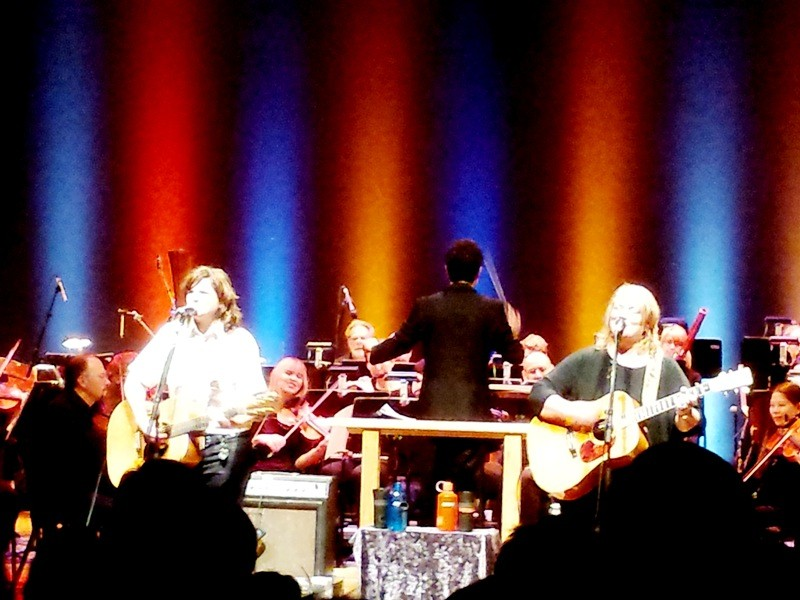Indigo Girls' Amy Ray (left) and Emily Saliers melded well with the Spokane Symphony during their 17-song set. - DAN NAILEN