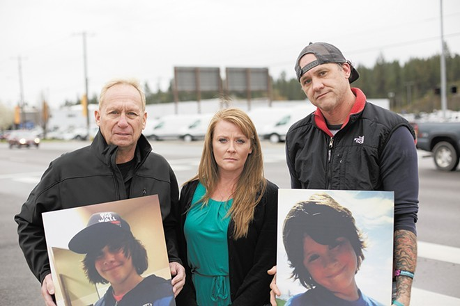 Ryan Holyk's family at intersection where he was killed - YOUNG KWAK PHOTO