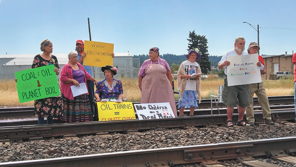"Three ""Raging Grannies"" were arrested after blocking the tracks last year, a protest that local activists hope will lead to a wave of more civil disobedience. - PHOTO COURTESY OF DEENA ROMOFF"