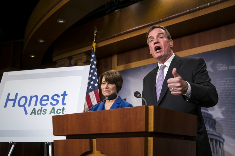 Sen. Mark Warner (D-Va.), joined by Sen. Amy Klobuchar (D-Minn.), talks about online political ads and preventing foreign interference in elections at a news conference on Capitol Hill in Washington, Oct. 19, 2017. Russian agents disseminated inflammatory posts that reached 126 million users on Facebook while uploading more than 1,000 videos to Google's YouTube service, according to two people familiar with the matter. - AL DRAGO/THE NEW YORK TIMES
