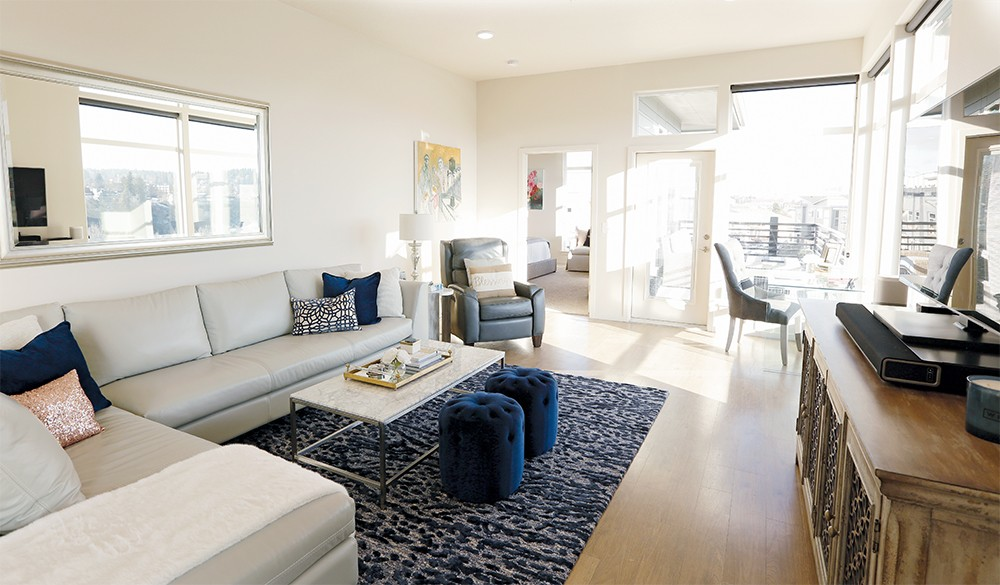 Laurie and James Allen's new home in Kendall Yards offers lots of light and quick access to all that downtown Spokane has to offer. - YOUNG KWAK
