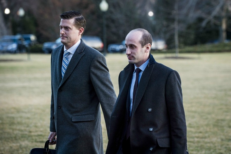White House Staff Secretary Rob Porter, left, and Stephen Miller, the senior policy adviser, cross the South Lawn at the White House in Washington, Feb. 5, 2018. Porter said Wednesday that he would resign his position, a day after a news account that quoted his two ex-wives accusing him of physical abuse during the course of their marriages. - PETE MAROVICH/ THE NEW YORK TIMES