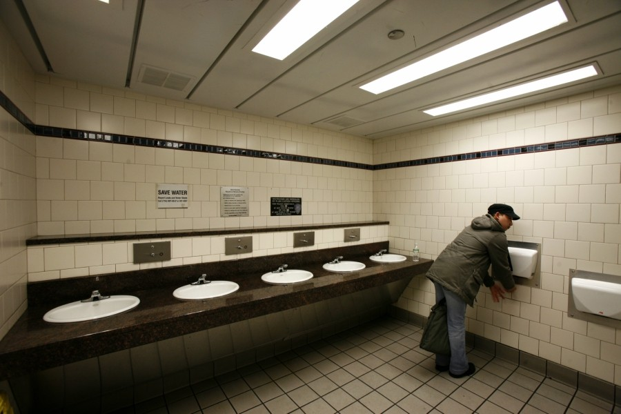 A hand dryer in use in a bathroom in New York, Jan. 12, 2008. Whether hand dryers spread pathogens is a matter of dispute among scientists. - GABRIELE STABILE/THE NEW YORK TIMES