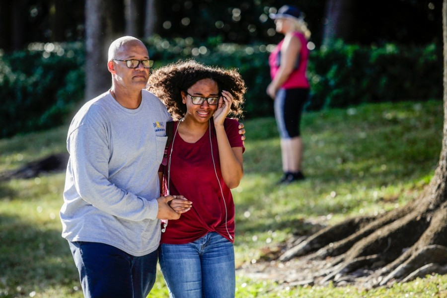 A father and daughter embrace after a mass shooting at the Marjory Stoneman Douglas High School in Parkland, Fla., Feb. 14, 2018. At least 17 people were killed Wednesday at this school about an hour northwest of Miami, law enforcement officials said. A suspect, a former student, is in custody. - SAUL MARTINEZ/THE NEW YORK TIMES