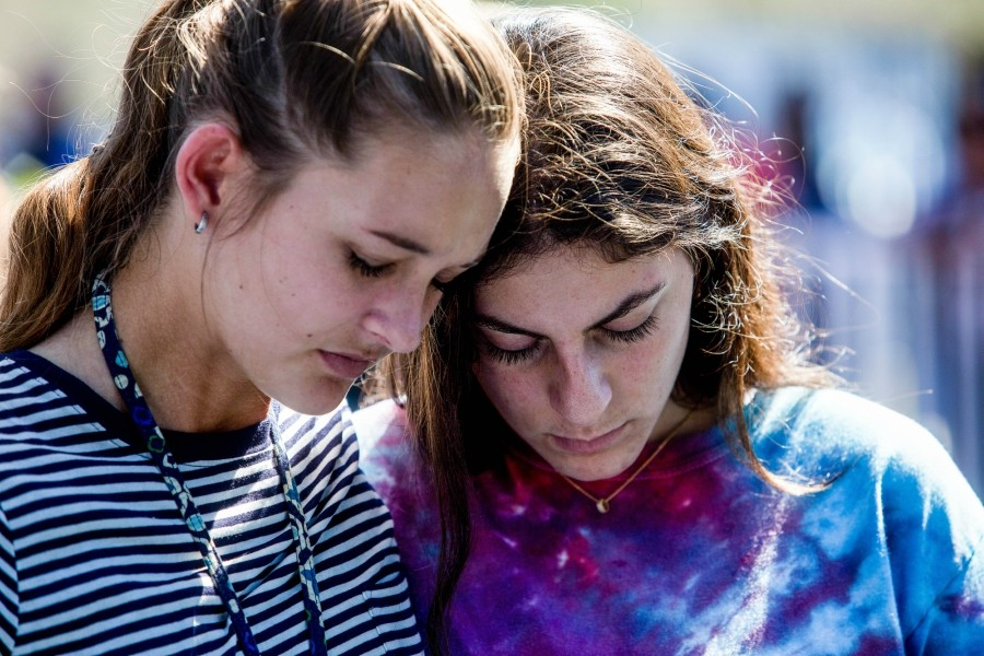 Students attend a prayer service at Parkridge Church in Coral Springs, Fla., a day after a mass shooting occurred at the nearby Marjory Stoneman Douglas High School, Feb. 15, 2018. Authorities on Thursday charged 19-year-old Nikolas Cruz – who is suspected of gunning down students and adults at the school – with 17 counts of premeditated murder. - SAUL MARTINEZ/THE NEW YORK TIMES