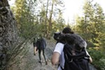 Brendan Love walks with his 1-year-old cat Fisher at the Bowl and Pitcher area at Riverside State Park in Spokane, Wash., Friday, June 15, 2018. (Young Kwak/The Inlander)