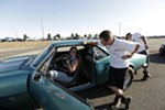 Miss Shifters member Jessica Boller, left, sits in her 1967 Chevrolet Camaro while speaking with her 16 year old son Dylan Boller, before a Powder Puff time trial.