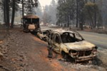 A line of vehicles that were abandoned along the road in Paradise, Calif., Nov. 11, 2018. Of the 23 people known on Sunday to have been killed by the fire in Paradise, six had died in their cars.
