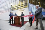 Spokane Public Facilities District Board Chair Nathaniel Greene, center, cuts the ribbon as (left to right) Board Vice Chair Larry Soehren, Board Member Travis Tramp, Board Member Marty Dickinson and Miick McDowell at the opening of the First Interstate Center for the Arts in Spokane, Wash., Monday, Nov. 5, 2018.