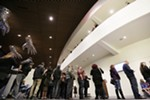 People wait in line to enter the theater during the opening of the First Interstate Center for the Arts in Spokane, Wash., Monday, Nov. 5, 2018.