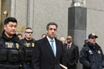 Michael Cohen, center, the former lawyer for President Donald Trump, exits federal court after his sentencing in Manhattan, Dec. 12, 2018. Cohen said he knew arranging payments during the campaign to quiet two women who claimed to have had affairs with the candidate was wrong. He said Trump knew it was wrong at the time, too.