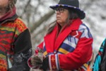 Terri Parr, a member of the Coeur d'Alene Tribe and the executive director of the Affiliated Tribes of Northwest Indians, holds burning sage as she listens to a speaker at Riverfront Park.