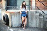 Fashion blogger Annessa Smith models the A-line skirt and tucked-in shirt look.