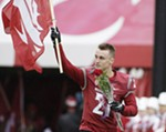 Washington State wide receiver River Cracraft (21) jogs onto the field as part of Senior Night events. Cracraft went out with what is believed to be an ACL injury during a game against California on Saturday, Nov. 12, 2016.