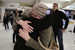 Hamas Fahan, right, hugs her mother-in-law Montaha Jawad, a refugee from Iraq.
