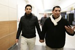Newly reunited brothers Hamid Nahi and Assad Al-Sawaedi hold hands — an Arab gesture of intense friendship or platonic love — as they walk to the baggage claim.