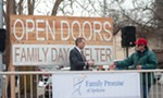 <b>Steve Allen, executive director of Family Promise of Spokane, goes to shake a man's hand while preparing for a celebration of the recent opening of Open Doors daytime shelter for homeless families.</b>