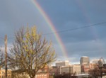 A rainbow plunges toward downtown Spokane in the early evening of 4/20.