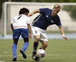 FCM Portland forward Giapoujay Garmondeh (7) and Spokane Shadow defender Kelly Kyllo (5) go after the ball during the first half.