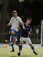 FCM Portland midfielder Ryo Asai, left, and Spokane Shadow defender Jackson Moore (3) go after the ball during the second half.