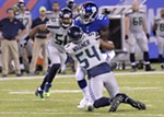 Bobby Wagner wraps up Giants running back Orleans Darkwa, while K.J. Wright closes in for the takedown.