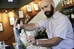 Bartender Steve Marriott adds water from a soda fountain for a Cucumber Lemonade Soda at Clover.