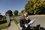 Spokane City Council candidate Kate Burke walks down E. Olympic Ave., near N. Nevada Ave. while doorbelling.